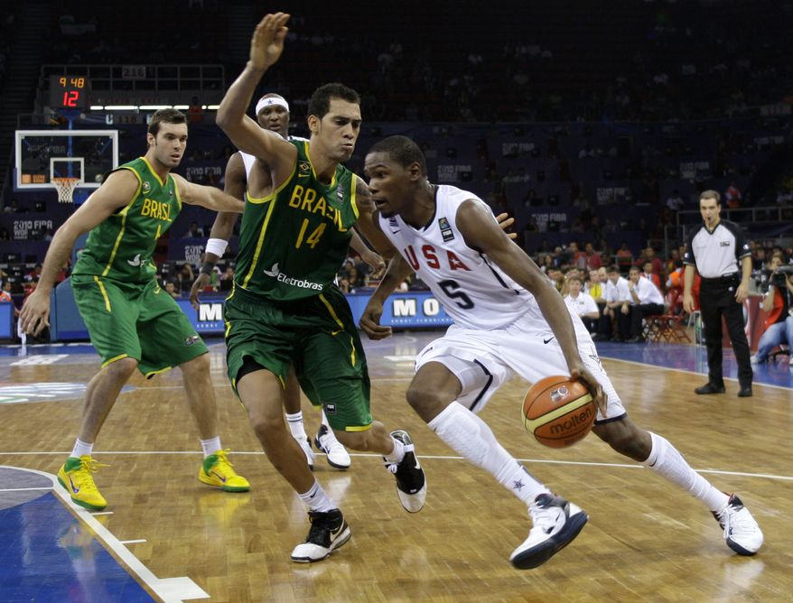 ASSOCIATED PRESS USA's Kevin Durant drives past Brazil's Marcus Vieira during their World Basketball Championship preliminary round match in Istanbul, Turkey, Monday Aug. 30, 2010.