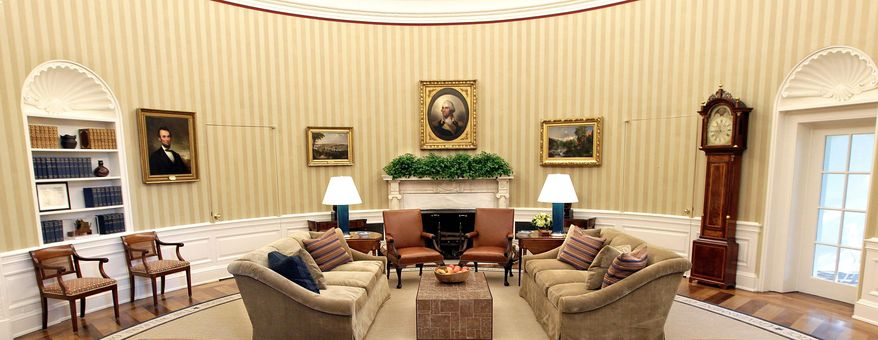 ASSOCIATED PRESS PHOTOGRAPHS A wide-angle presidential view of the renovated Oval Office shows new carpeting, drapes, wallpaper and furniture. A pair of former President George W. Bush's fireside armchairs have been reupholstered in caramel-colored leather, and there are two new custom-made sofas.