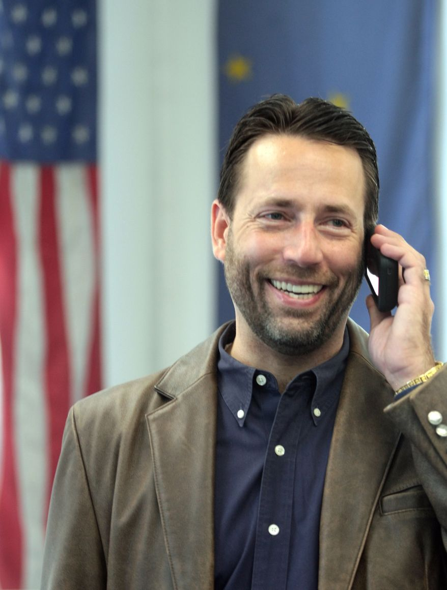 **FILE** Alaska U.S. Senate candidate Joe Miller makes phone calls from his law office in Fairbanks, Alaska, on Aug. 26, 2010. Miller, 43, stunned political pundits this week with his 1,688-vote lead over Sen. Lisa Murkowski, R-Alaska, in the Republican primary. (Associated Press)