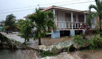 Floodwaters from a nearby river surround a house after heavy rains from Hurricane Earl hammered Potters Village, on the outskirts of St. John's, Antigua, on Monday, Aug. 30, 2010. (AP Photo/Johnny Jno-Baptiste)