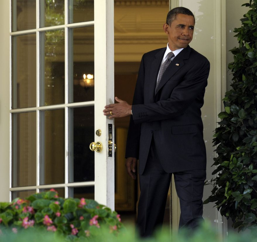 President Obama walks out of the Oval Office of the White House on Monday to make a statement on the economy in the Rose Garden. (Associated Press)