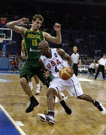 USA 's Chauncey Billups drives past Brazil's Tiago Splitter during their World Basketball Championship preliminary round match in Istanbul, Turkey, Monday Aug. 30, 2010. (AP Photo/Ibrahim Usta)