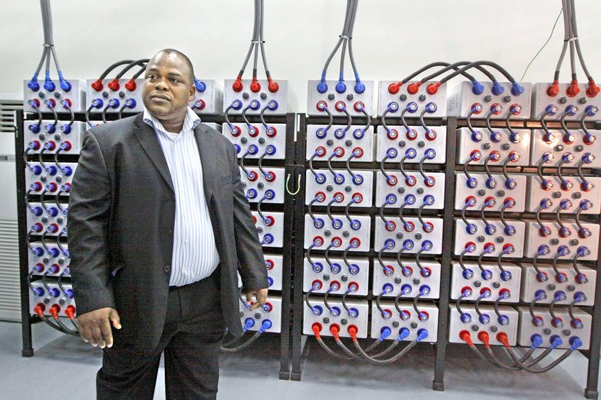 Johnnie Coleman, of MainOne Cable, walks past submarine-line terminating equipment at the cable-landing station in Lagos, Nigeria, on Aug. 5. This summer, a new $250 million MainOne cable snaked along the West African coastline, ending at Lagos, Nigeria's commercial capital. (Associated Press)