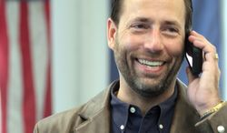 *FILE PHOTO* ASSOCIATED PRESS. Joe Miller is seen in his Fairbanks, Alaska, law office on Thursday. Sen. Lisa Murkowski conceded the GOP primary to him in late August.