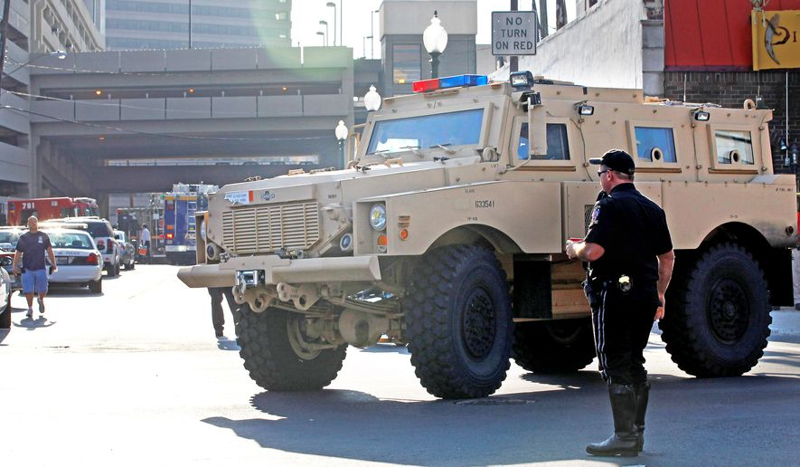 An armored vehicle stands by at the Discovery Channel building in Silver Spring on Wednesday during a hostage situation. Police fatally shot a gunman who, upset with the company's programming, took two employees and a security officer hostage at the channel's headquarters. (AP Photo)