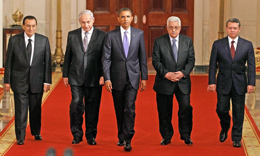 NEGOTIATORS: President Obama walks with Mideast leaders, from left, Hosni Mubarak, Benjamin Netanyahu, Mahmoud Abbas and King Abdullah II to the East Room to make a statement about peace talks. (Associated Press)