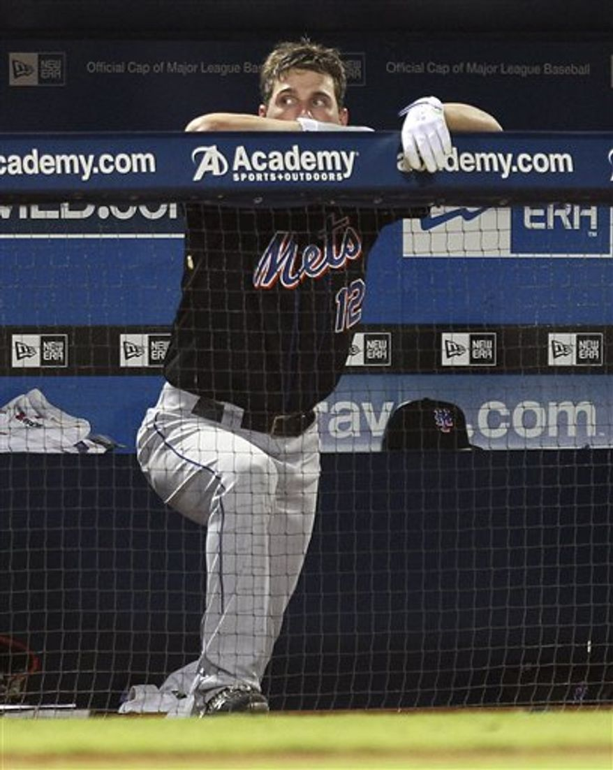 New York Mets' Jeff Francoeur (12) looks on from the dugout in the ninth inning of a baseball game against the Atlanta Braves in Atlanta, Monday, Aug. 30, 2010. Atlanta won 9-3.  (AP Photo/John Bazemore)
