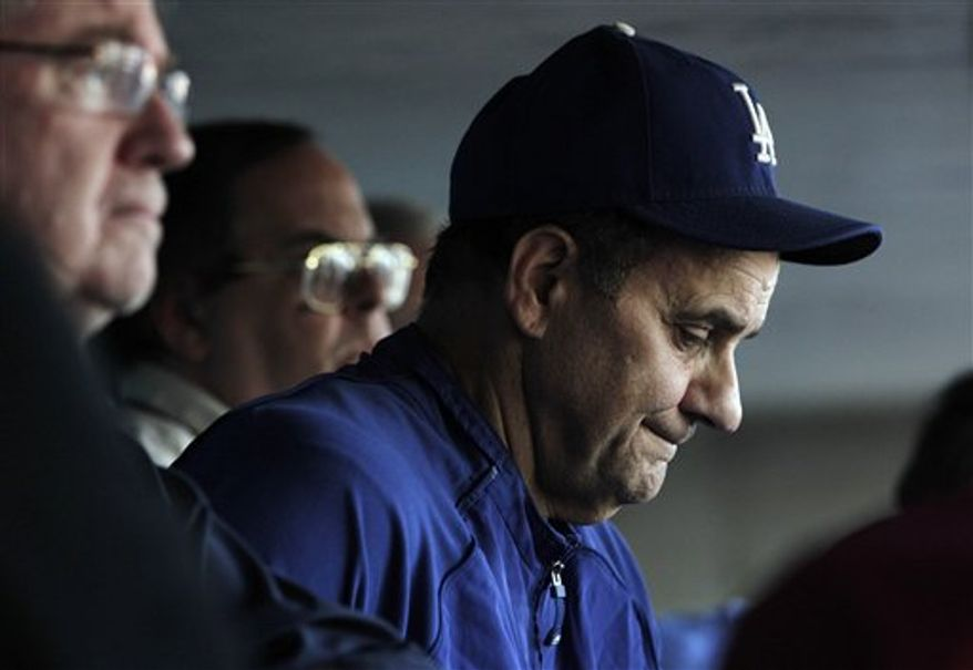 Los Angeles Dodgers manager Joe Torre pauses for a moment while answering questions about Manny Ramirez before a baseball game against the Philadelphia Phillies in Los Angeles, Monday, Aug. 30, 2010. As expected, the White Sox claimed the unpredictable but productive 12-time All-Star slugger on waivers from the Dodgers, counting on his powerful bat, full of so many October swings and homers, to help them make a postseason push. (AP Photo/Jae C. Hong)