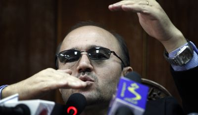 ** FILE ** Afghan central bank Gov. Abdul Qadir Fitrat gestures during a press conference in Kabul, Afghanistan, on Wednesday, Sept. 1, 2010. Mr. Fitrat expressed confidence in the solvency of Kabul Bank, the nation's biggest bank, which has been the target of allegations of mismanagement and illegitimate activities. (AP Photo/Musadeq Sadeq)