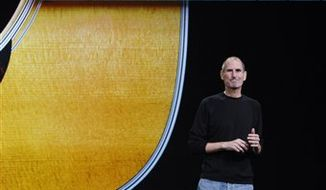 Apple CEO Steve Jobs shows the new Apple iPad display, at a news conference in San Francisco, Wednesday, Sept. 1, 2010. (AP Photo/Paul Sakuma)