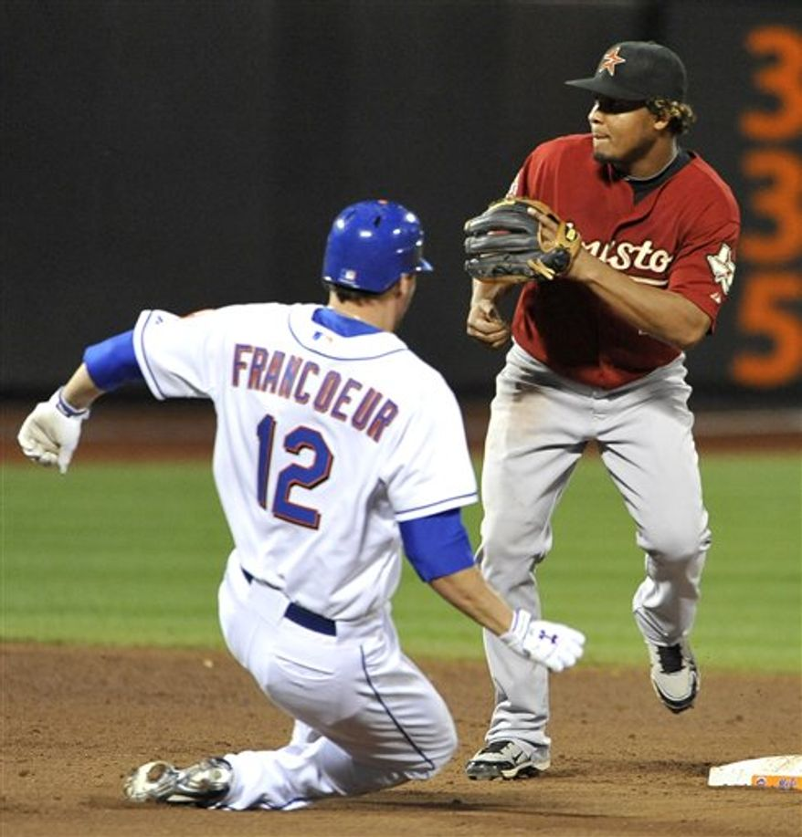 New York Mets' Jeff Franceour beats the throw to Houston Astros' second baseman Anderson Hernandez to steal second base in the sixth inning of a baseball game Friday, Aug. 27, 2010, in New York. (AP Photo/Kathy Kmonicek)