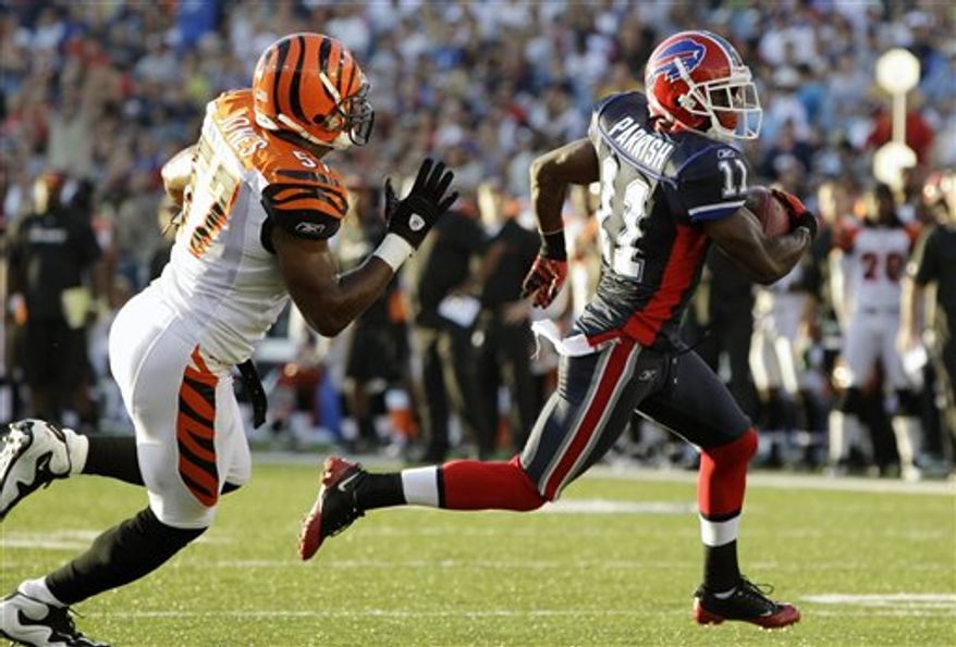 Buffalo Bills' Roscoe Parrish (11) makes a touchdown catch under pressure from Cincinnati Bengals' Dhani Jones (57) during the first half of an NFL preseason football game in Orchard Park, N.Y., Saturday, Aug. 28, 2010. (AP Photo/ David Duprey)
