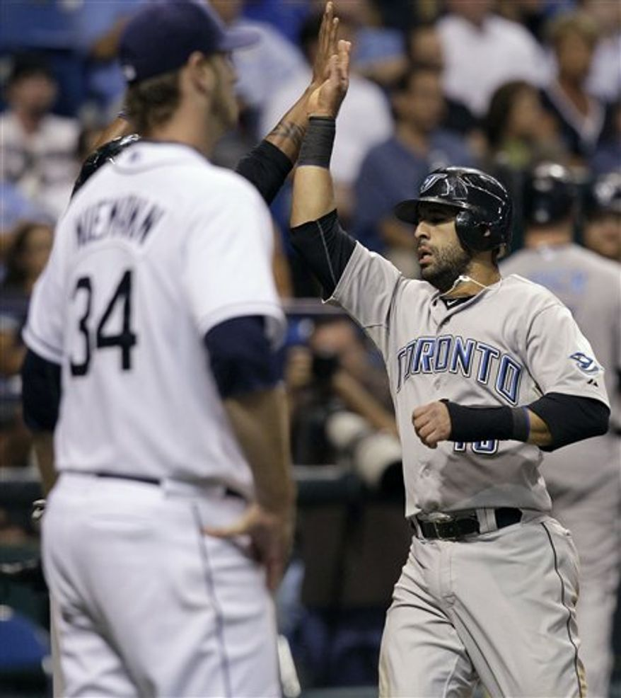 Toronto Blue Jays' Jose Bautista grimaces as he gets hit with a sixth inning pitch by Tampa Bay Rays starting pitcher Jeff Niemann during a baseball game Tuesday, Aug. 31, 2010, in St. Petersburg, Fla. (AP Photo/Chris O'Meara)