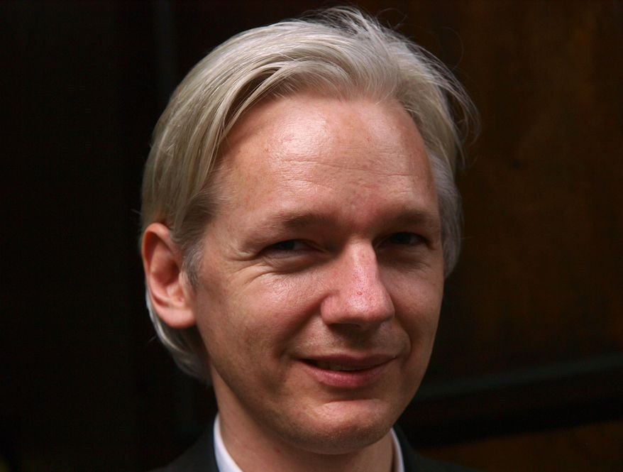 In this Tuesday, July 27, 2010, file picture founder and editor of the WikiLeaks website, Julian Assange, faces the media during a debate event, held in London, England. The lawyer for Mr. Assange said his client has been questioned by Swedish police regarding allegations of molestation. Leif Silbersky said Mr. Assange was questioned by police in Stockholm for about an hour late Monday and was formally informed of the suspicions against him.(AP Photo/Max Nash)