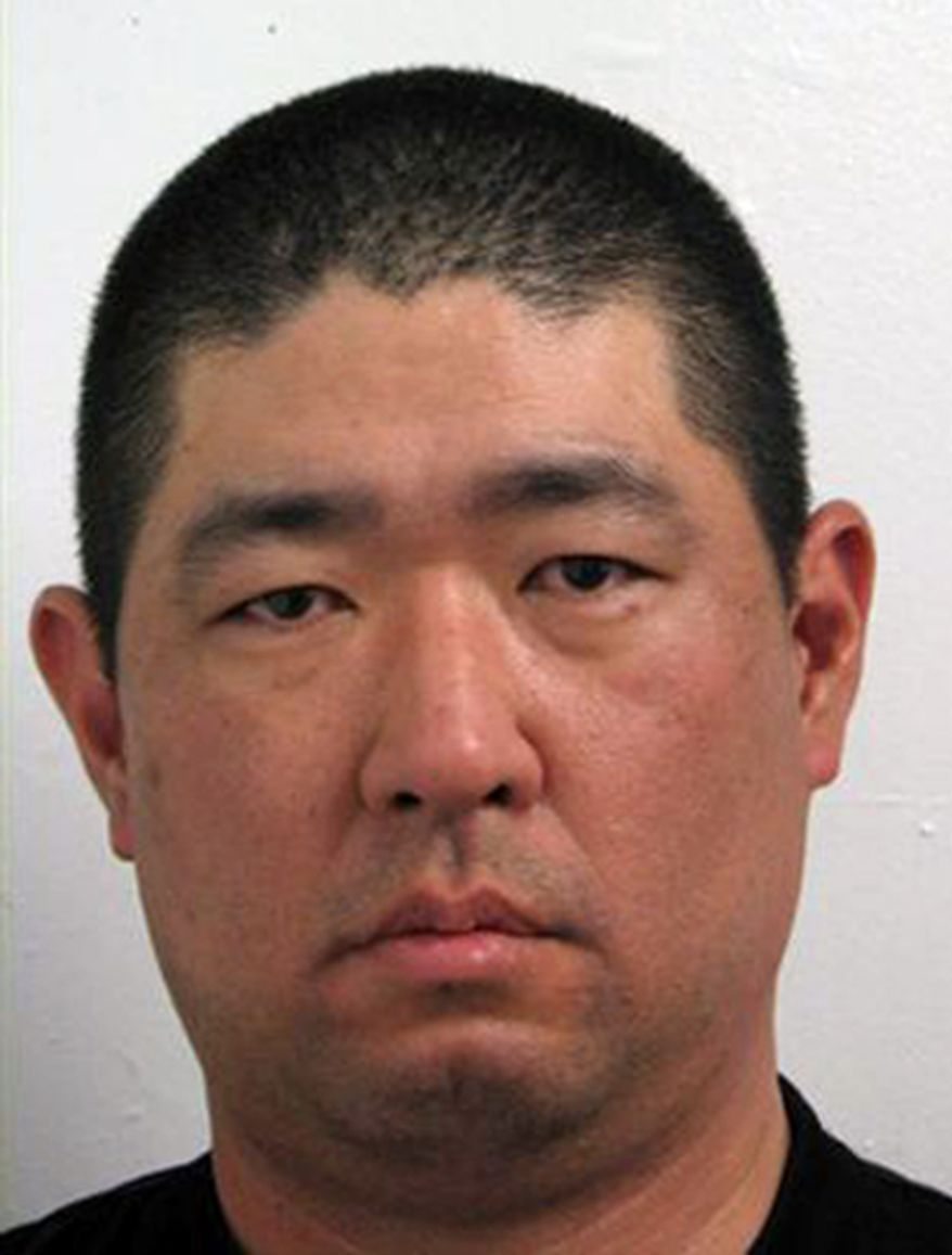 """In this image released by the Montgomery County Police, James J. Lee is seen is a booking mugshot from 2008 on disorderly conduct. Lee, 43, a gunman with what police described as """"concerns"""" with the Discovery Channel networks took at least one person hostage in the company's Silver Spring, Md., headquarters Wednesday, Sept. 1, 2010. A law enforcement official speaking on condition of anonymity because the investigation is ongoing said authorities have identified Lee as the likely suspect. (AP Photo/Montgomery County (Md.) Police)"""