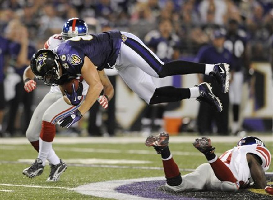 Baltimore Ravens quarterback Joe Flacco rolls out to pass against the New York Giants during the first half of an NFL preseason football game, Saturday, Aug. 28, 2010, in Baltimore. (AP Photo/Rob Carr)