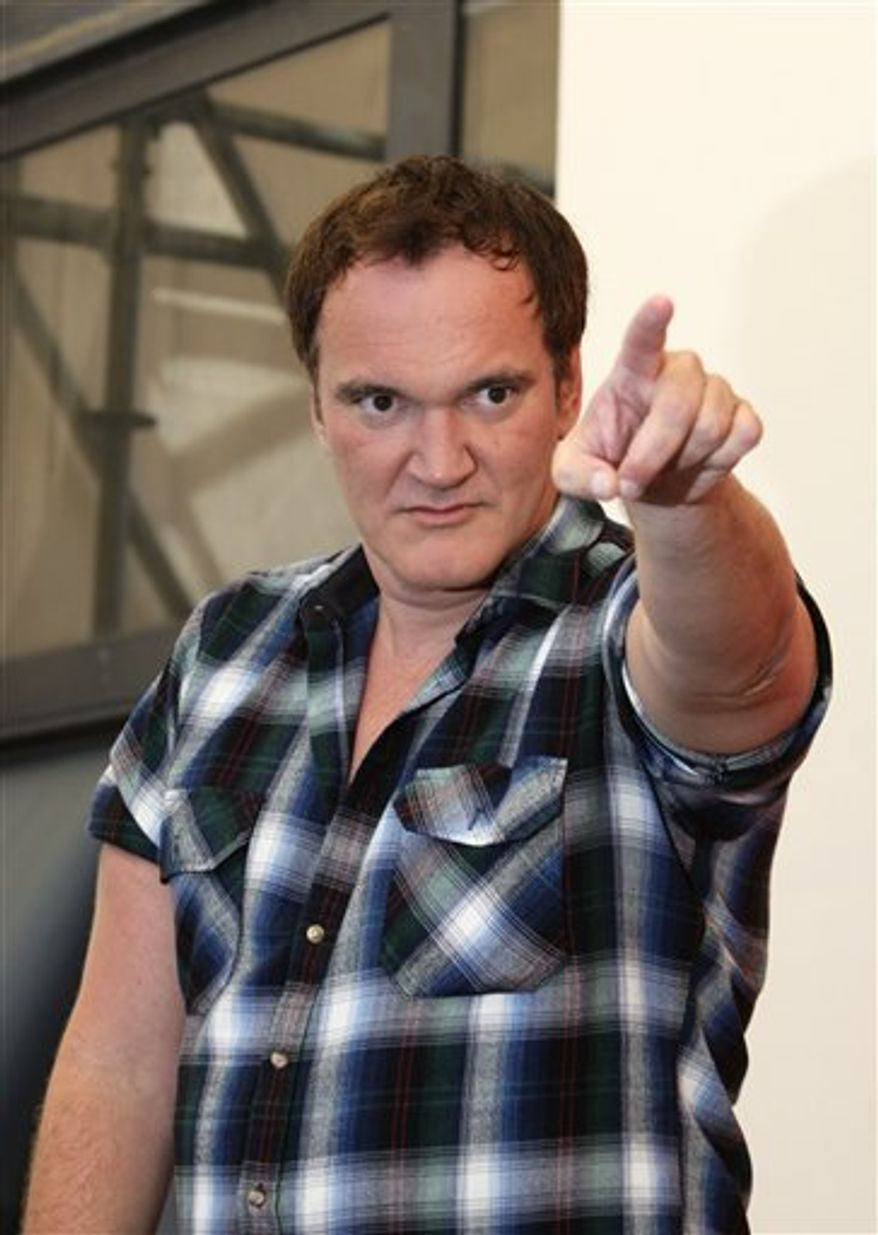 Jury President Quentin Tarantino gestures during the jury photo call at the 67th edition of the Venice Film Festival in Venice, Italy, Wednesday, Sept. 1, 2010. (AP Photo/Domenico Stinellis)