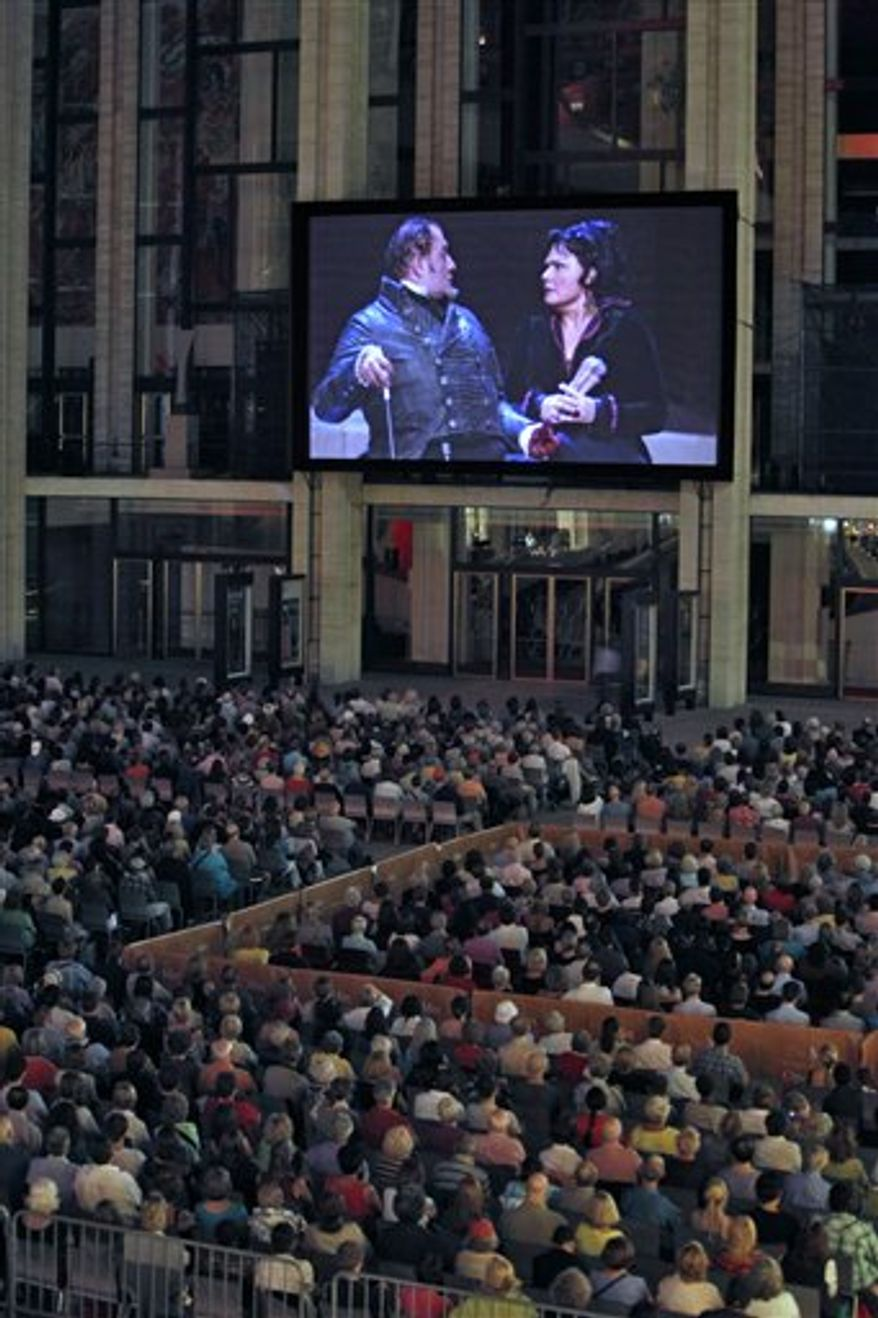 "FILE--In this file photo from Wednesday, Jan. 9, 2008, producers in a mobile broadcast studio outside the Metropolitan Opera studio, conduct a rehearsal taping of Verdi's ""MacBeth"" in New York, before a live broadcast to movie audiences world-wide.  The Metropolitan Opera's Emmy and Peabody Award-winning ""Live in HD"" live-from-the-stage series for movie theaters is expanding their reach to 1,500 theaters in 46 countries.  (AP Photo/Julie Jacobson, File)"