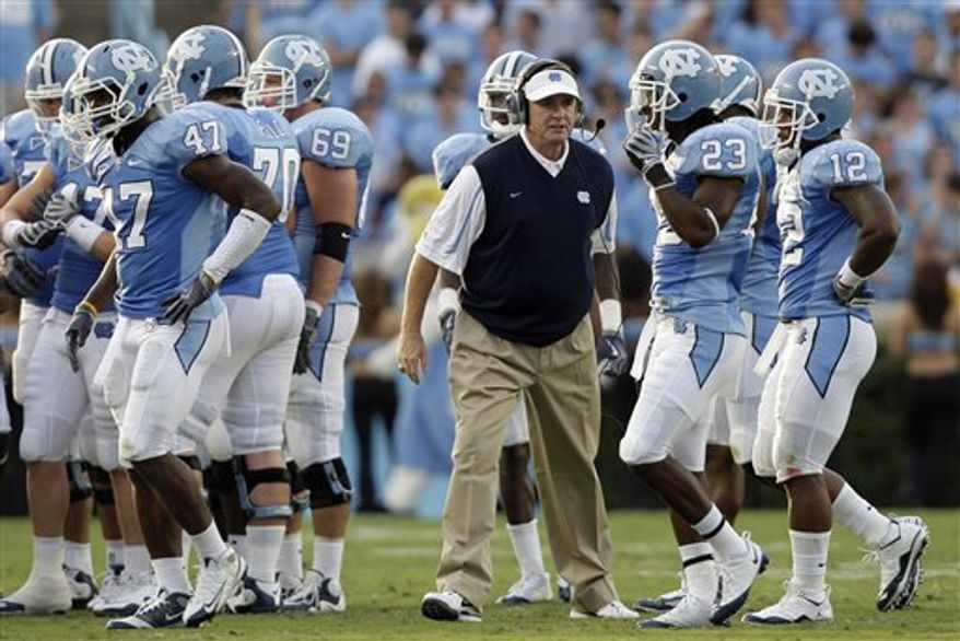 In this Sept. 5, 2009, photo, North Carolina coach Butch Davis speaks to his team between plays during the first half of an NCAA college football game against The Citadel in Chapel Hill, N.C. Less than a week away from the high-profile opener that will kick off North Carolina's fourth season under coach Butch Davis, the 18th-ranked Tar Heels aren't sure exactly who will be playing for them against No. 21 LSU in Atlanta. (AP Photo/Gerry Broome)
