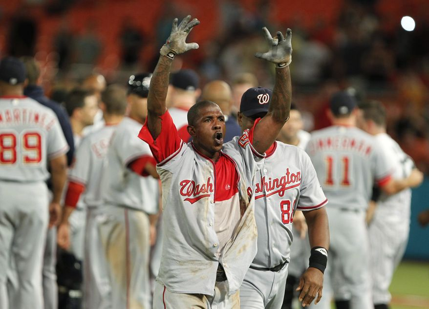 ASSOCIATED PRESS Washington Nationals' Nyjer Morgan, center, is led off the field after a brawl during the sixth inning of a baseball game against the Florida Marlins, Wednesday, Sept. 1, 2010, in Miami.
