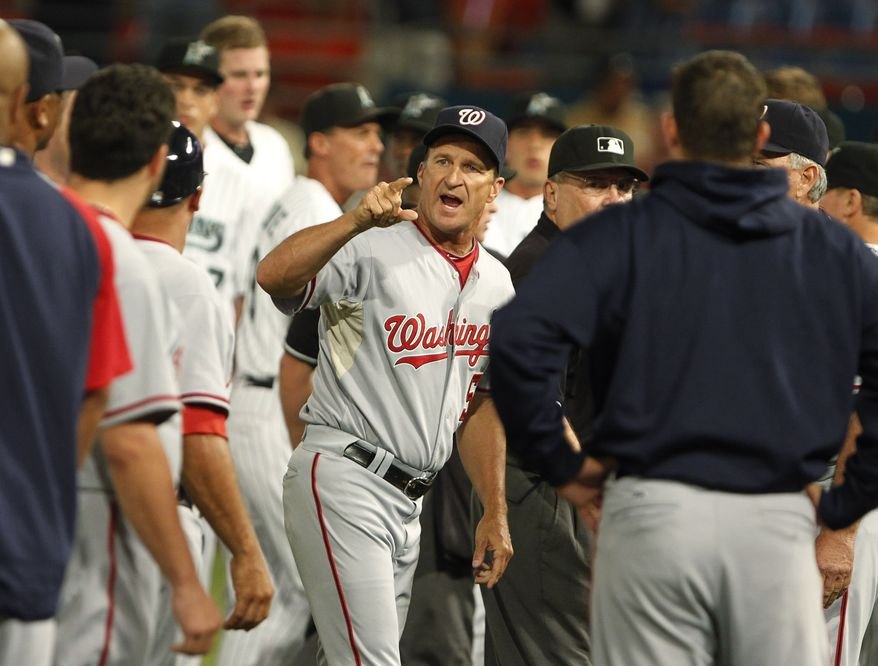 ASSOCIATED PRESS Washington Nationals manager Jim Riggleman, center, gestures after a bench-clearing brawl during the sixth inning of a baseball game against the Florida Marlins, Wednesday, Sept. 1, 2010, in Miami.