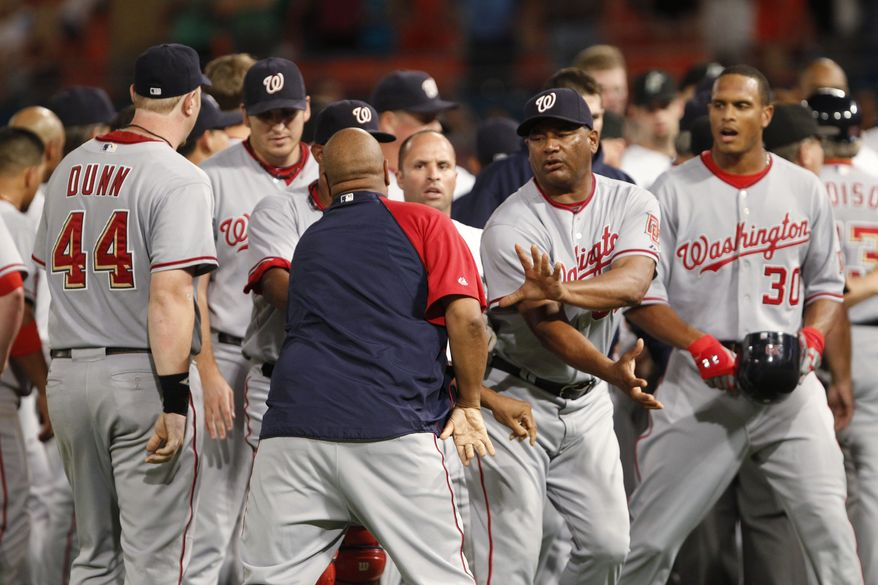 ASSOCIATED PRESS Washington Nationals players gather as a brawl with the Florida Marlins winds down during the sixth inning of a baseball game Wednesday, Sept. 1, 2010, in Miami.