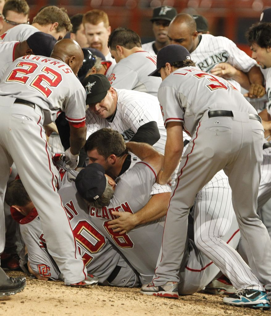 ASSOCIATED PRESS Florida Marlins  and Washington Nationals players fall to the ground during a brawl in the sixth inning of a baseball game Wednesday, Sept. 1, 2010 in Miami. Nationals' Nyjer Morgan charged the mound after a pitch from Florida's Chris Volstad sailed behind him.