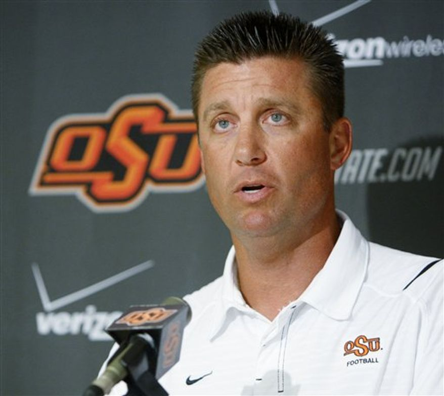 Mike Gundy, coach of Oklahoma State NCAA college football team, answers a question during a news conference Monday, Aug. 30, 2010, in Stillwater, Okla. (AP Photo/Sue Ogrocki)