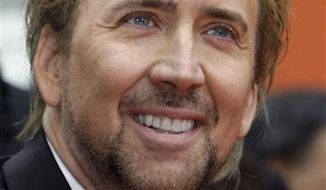 FILE - In this May 17, 2010 file photo, actor Nicolas Cage is shown at Grauman's Chinese Theatre in the Hollywood district of Los Angeles. (AP Photo/Reed Saxon, file)