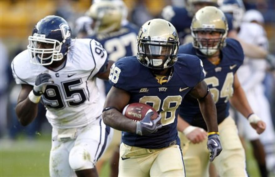 FILE- In this Oct. 10, 2009, file photo, Pittsburgh freshman running back Dion Lewis (28) carries the ball against Connecticut during an NCAA college football game in Pittsburgh. Only one Pitt running back, Tony Dorsett, had a season like Dion Lewis' a year ago. In only a couple of months, Lewis went from unknown freshman to second-team All-American. Still, one year later, some teammates still don't know what makes Dion Lewis run.  (AP Photo/Keith Srakocic, File)