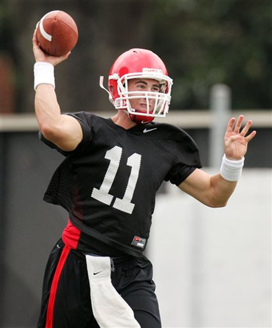 FILE - This file photo taken Aug. 17, 2010, shows Georgia's freshman quarterback Aaron Murray, 19, at the practice field in Athens, Ga. No. 23 Georgia needs him to relax in his first NCAA college football game start Saturday, Sept. 4, 2010. (AP Photo/Atlanta Journal & Constitution, Jason Getz)