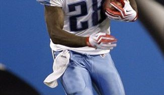 FILE - In this Aug. 28, 2010, file photo, Tennessee Titans running back Chris Johnson carries the ball against the Carolina Panthers during a preseason NFL football game in Charlotte, N.C. The tattoos on Chris Johnson's body, starting with wings just above his collarbone, remind the world that the Titans' running back is the NFL's most recent member of the rare club of 2,000-yard rushers. The Offensive Player of the Year is back with even bigger goals. (AP Photo/Rusty Burroughs, File)
