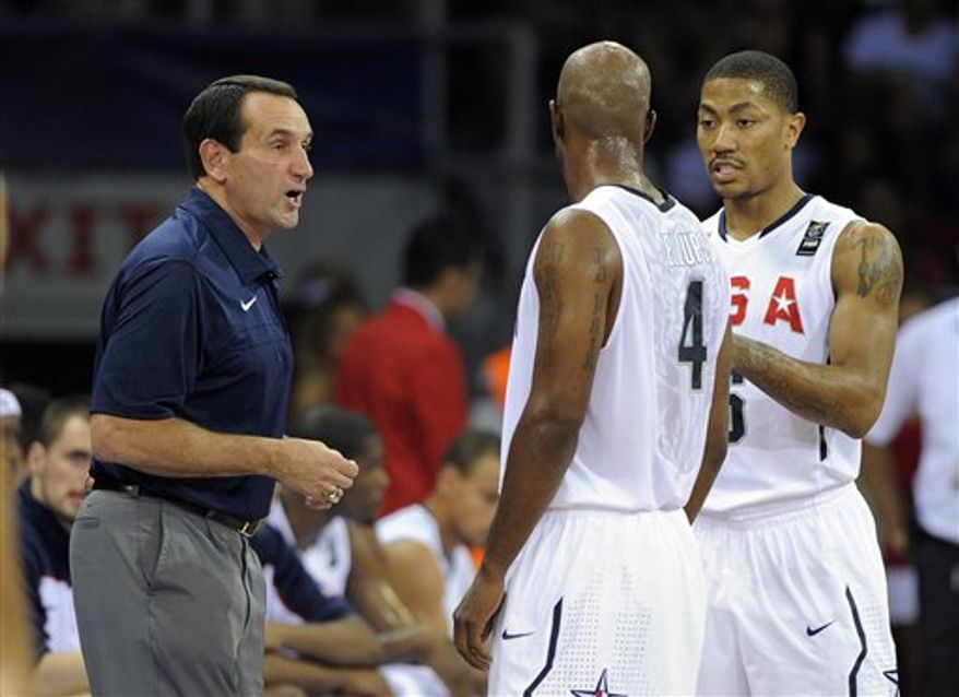 USA head coach Mike Krzyzewski, left, talks with Chauncey Billups, center, and  Derrick Rose during the preliminary round of the World Basketball Championship, Saturday, Aug. 28, 2010, in Istanbul, Turkey.  (AP Photo/Mark J. Terrill)