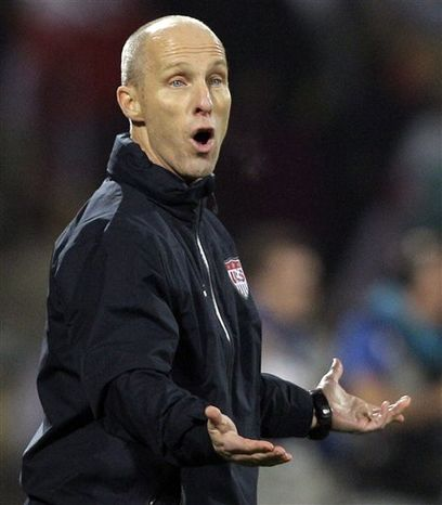 FILE - IN a June 12, 2010, file photo, U.S. soccer coach Bob Bradley gestures during a World Cup group C match between England and the United States at Royal Bafokeng Stadium in Rustenburg, South Africa. Bradley will remain coach of the U.S. men's soccer team through the 2014 World Cup. U.S. Soccer announced late Monday, Aug. 30, 2010, it had agreed to a four-year contract extension with Bradley, whose current deal expires in December. (AP Photo/Elise Amendola, File)