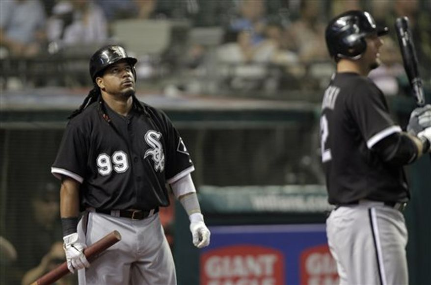 Chicago White Sox's Adam Dunn (32) hits a two-run home run off Cleveland Indians starting pitcher Fausto Carmona in the third inning in an opening day baseball game, Friday, April 1, 2011, in Cleveland. (AP Photo/Tony Dejak)