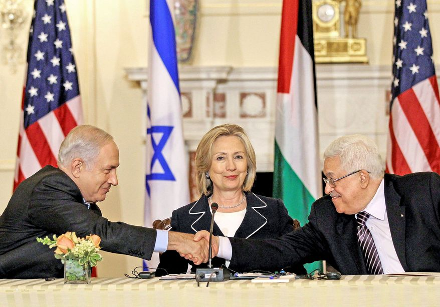 ** FILE ** Palestinian Authority President Mahmoud Abbas (right) and Israeli Prime Minister Benjamin Netanyahu shake hands as Secretary of State Hillary Rodham Clinton hosts the relaunch of peace talks at the State Department in Washington on Thursday, Sept. 2, 2010. (AP Photo)
