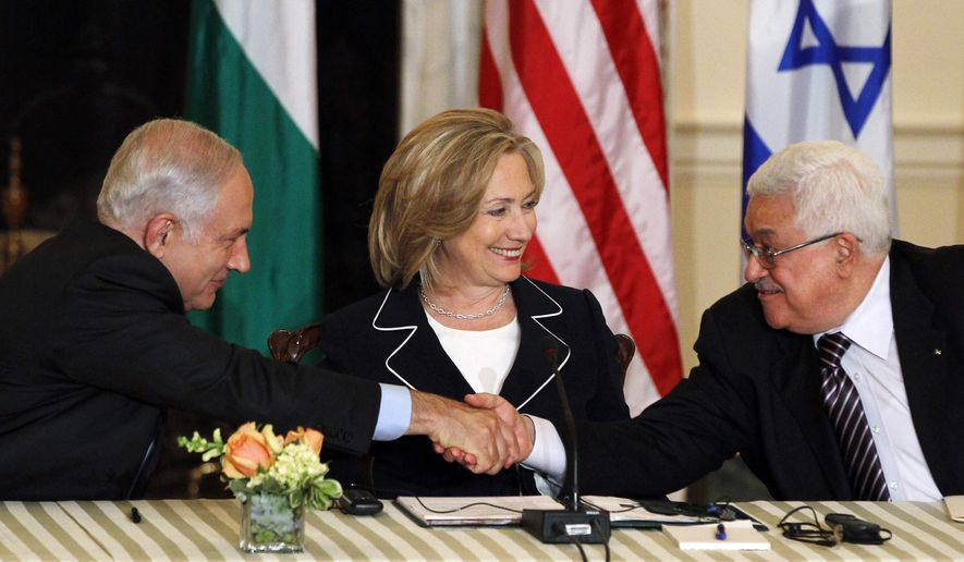 Secretary of State Hillary Rodham Clinton looks on as Palestinian Authority President Mahmoud Abbas, right, and Israeli Prime Minister Benjamin Netanyahu shake hands as she hosts the re-launch of direct negotiations, Thursday, Sept. 2, 2010, at the State Department in Washington. (AP Photo/Charles Dharapak)