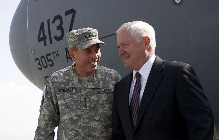 Defense Secretary Robert Gates, right, is greeted by top NATO commander Gen. David Petraeus as he arrives in Kabul, Afghanistan on Thursday, Sept. 2, 2010. (AP Photo/Jim Watson, Pool)
