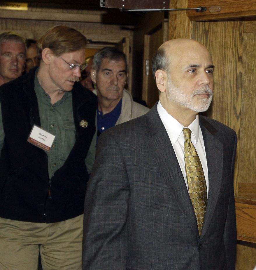 Federal Reserve Chairman Ben Bernanke, right, and Robert Zoellick, left, president of the World Bank, leave for the lunch break from the morning session of the annual Federal Reserve conference, Friday, Aug. 27, 2010, in Jackson, Wyo. (AP Photo/Reed Saxon)