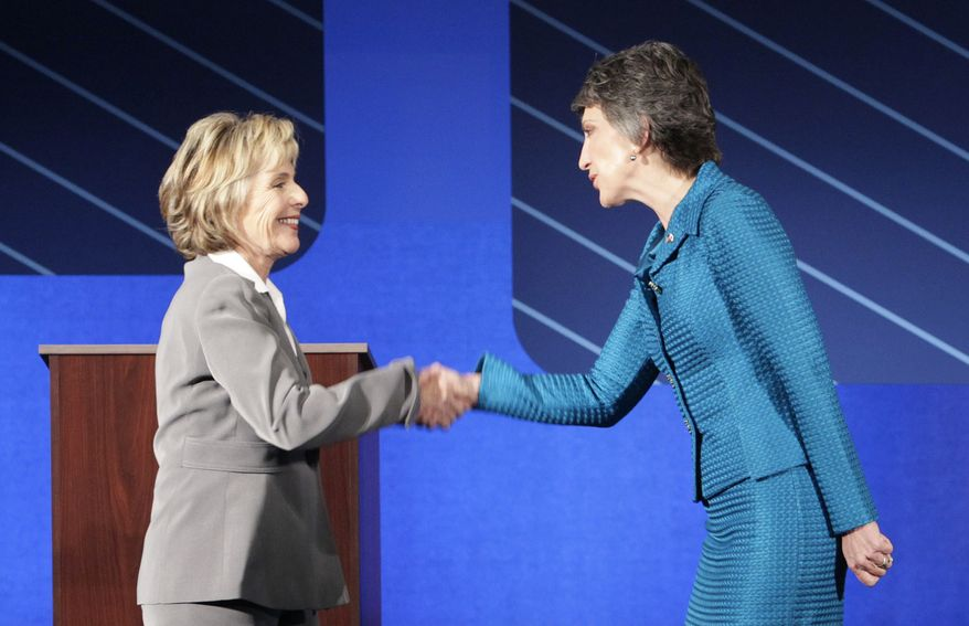 Democratic Sen. Barbara Boxer, left, shakes hands with Republican Carly Fiorina before a debate at St. Mary's College in Moraga, Calif., Wednesday, Sept. 1, 2010. (AP Photo/Jeff Chiu, Pool)