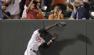 ASSOCIATED PRESS Baltimore Orioles left fielder Felix Pie misses a three-run home run hit by Boston Red Sox's Adrian Beltre during the seventh inning of a baseball game, Wednesday, Sept. 1, 2010, in Baltimore. The Red Sox won 9-6.