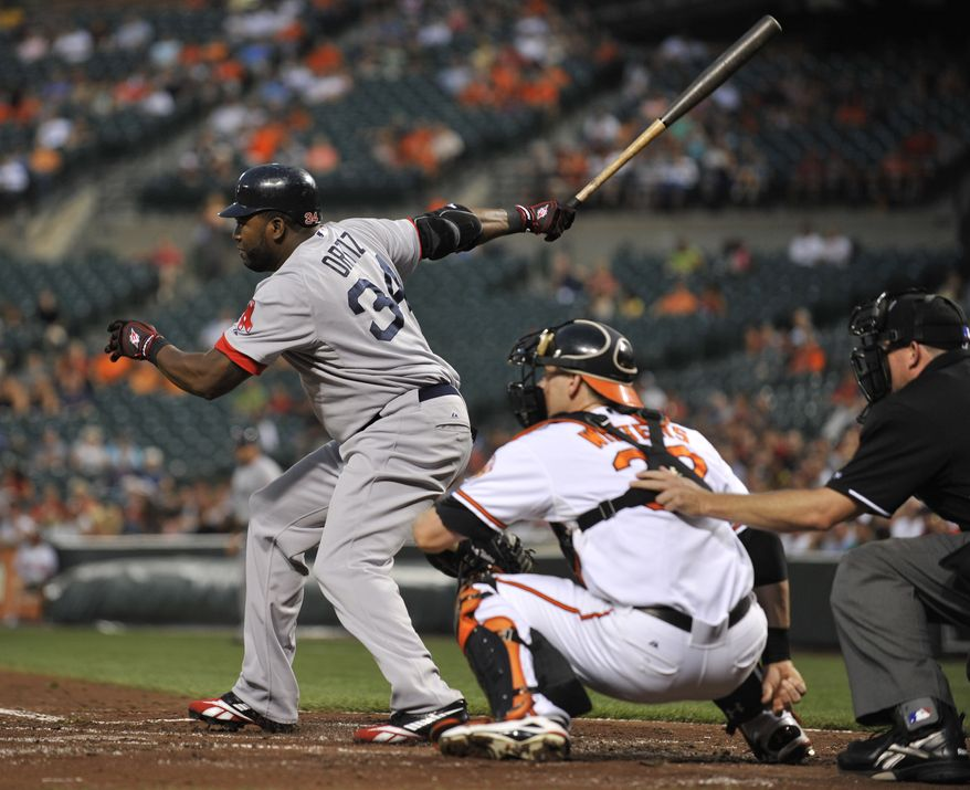 ASSOCIATED PRESS Boston Red Sox's David Ortiz follows through on an RBI two-run single in the second inning of a baseball game Thursday, Sept. 2, 2010 in Baltimore. Also pictured is Baltimore Orioles catcher Matt Wieters and home plate umpire Ron Kulpa. The Red Sox won 6-4.