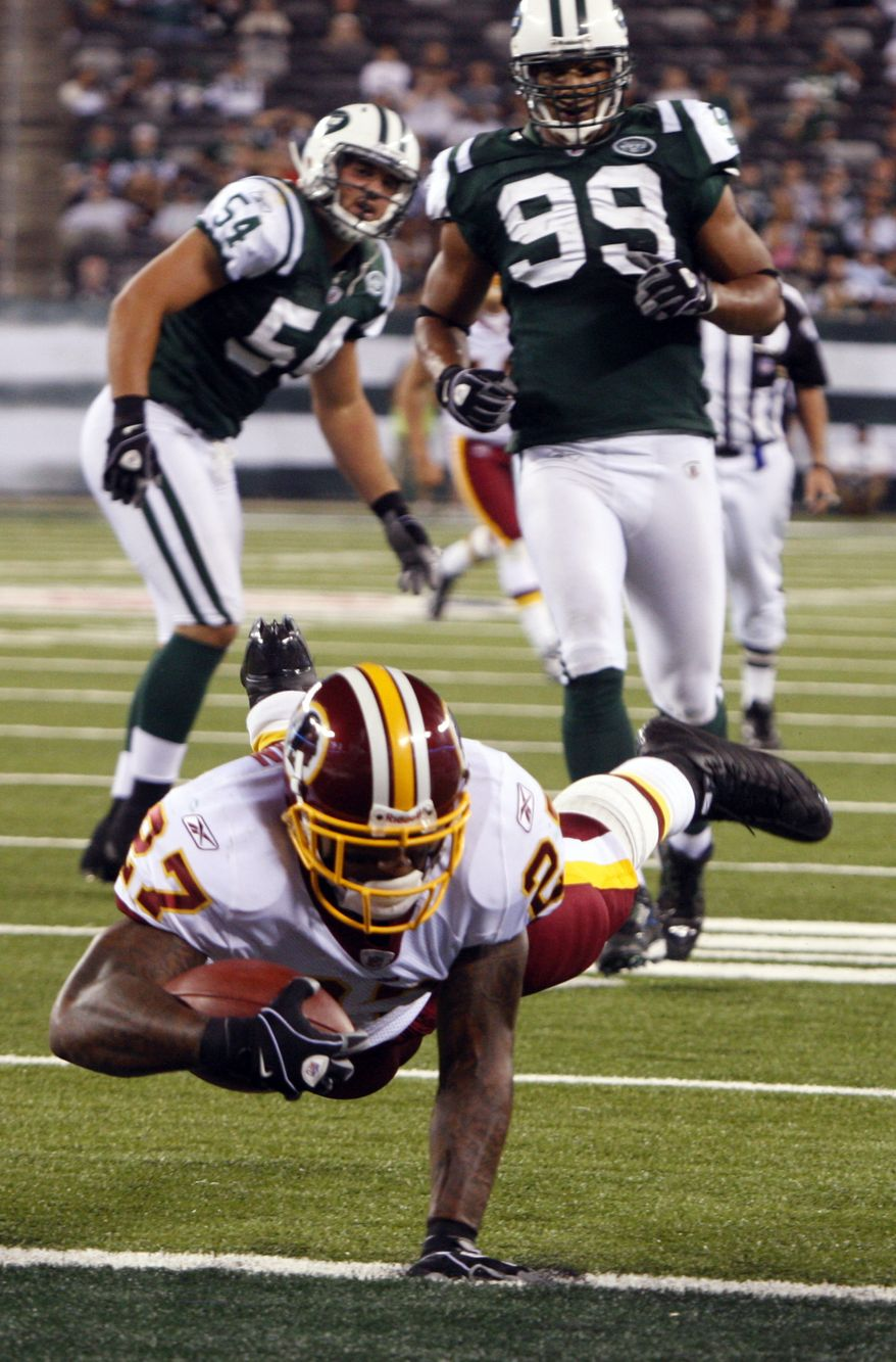 ASSOCIATED PRESS Washington Redskins running back Larry Johnson, foreground, scores a touchdown as New York Jets' Jason Taylor (99) and teammate Kenwin Cummings (54) look on during the fourth quarter of an NFL preseason football game at New Meadowlands Stadium in East Rutherford, N.J., Friday, Aug. 27, 2010. The Redskins won the game 16-11.