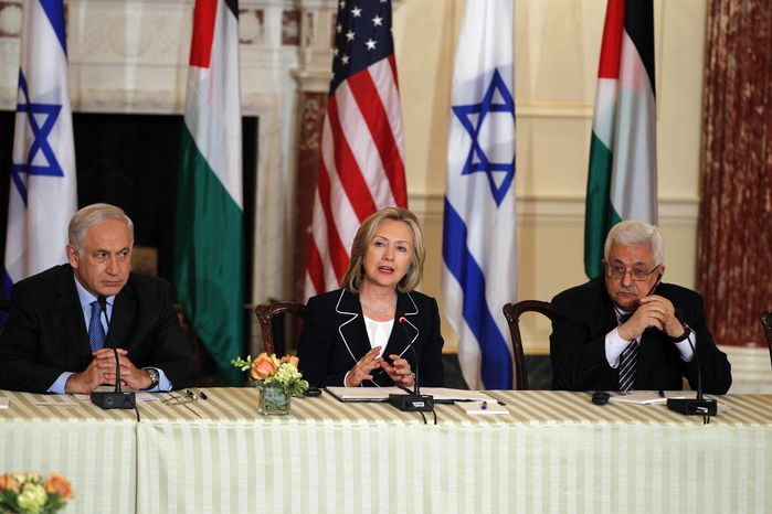 Secretary of State Hillary Rodham Clinton sits with Palestinian Authority President Mahmoud Abbas, right, and Israeli Prime Minister Benjamin Netanyahu as she hosts the re-launch of direct negotiations, Thursday, Sept. 2, 2010, at the State Department in Washington. (AP Photo/Charles Dharapak)