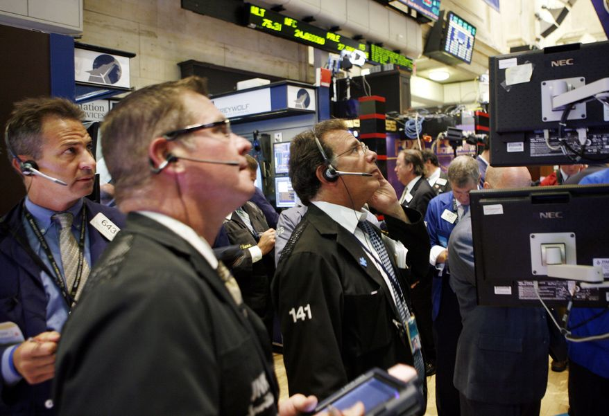 In this Sept. 1, 2010 ,photo, traders and specialists work the trading floor of the New York Stock Exchange, in New York. (AP Photo/David Karp)