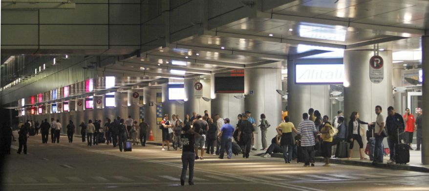Passengers head out of the terminal at Miami International Airport early Friday morning, Sept. 3, 2010. A spokesman for the airport said four of its six concourses were evacuated as a police bomb squad investigated a report of a suspicious item. Several flights were diverted to other parts of the terminal.(AP Photo/Alan Diaz)