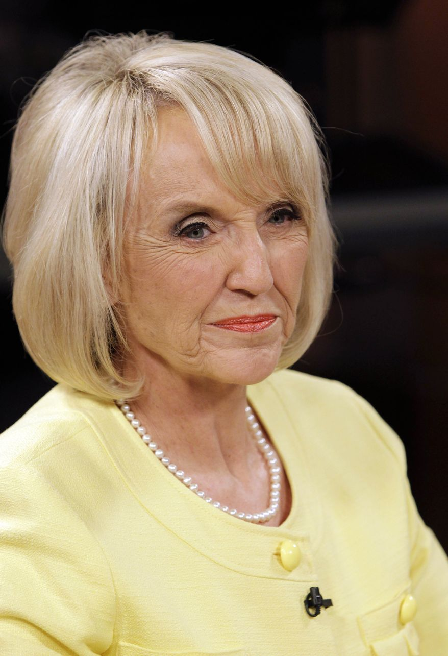 Republican Arizona Gov. Jan Brewer, shown waiting for a televised Arizona gubernatorial debate to begin Wednesday, Sept. 1, 2010, in Phoenix. (AP Photo/Matt York)