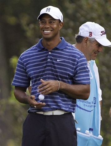 Tiger Woods reads the green on the first hole during the final round at the Deutsche Bank Championship golf tournament at TPC Boston, in Norton, Mass., Monday, Sept. 6, 2010. (AP Photo/Stew Milne)