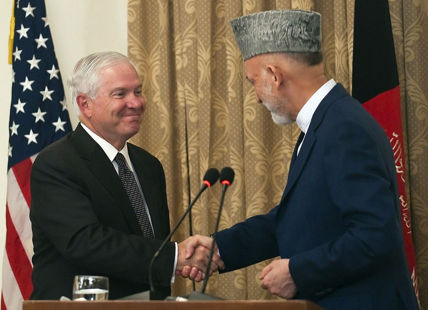 Afghanistan President Hamid Karzai, right, shakes hands with Secretary of Defense Robert Gates during a joint press conference at the Presidential Palace in Kabul, Afghanistan, Thursday, Sept. 2, 2010. (AP Photo/Jim Watson, Pool)