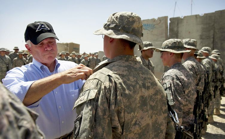 Defense Secretary Robert Gates participates in an award ceremony for a group of soldiers from the 1st Battalion, 502nd Infantry Regiment, at combat outpost Senjaray outside Kandahar, Afghanistan, Friday, Sept. 3, 2010. (AP Photo/Jim Watson, Pool)